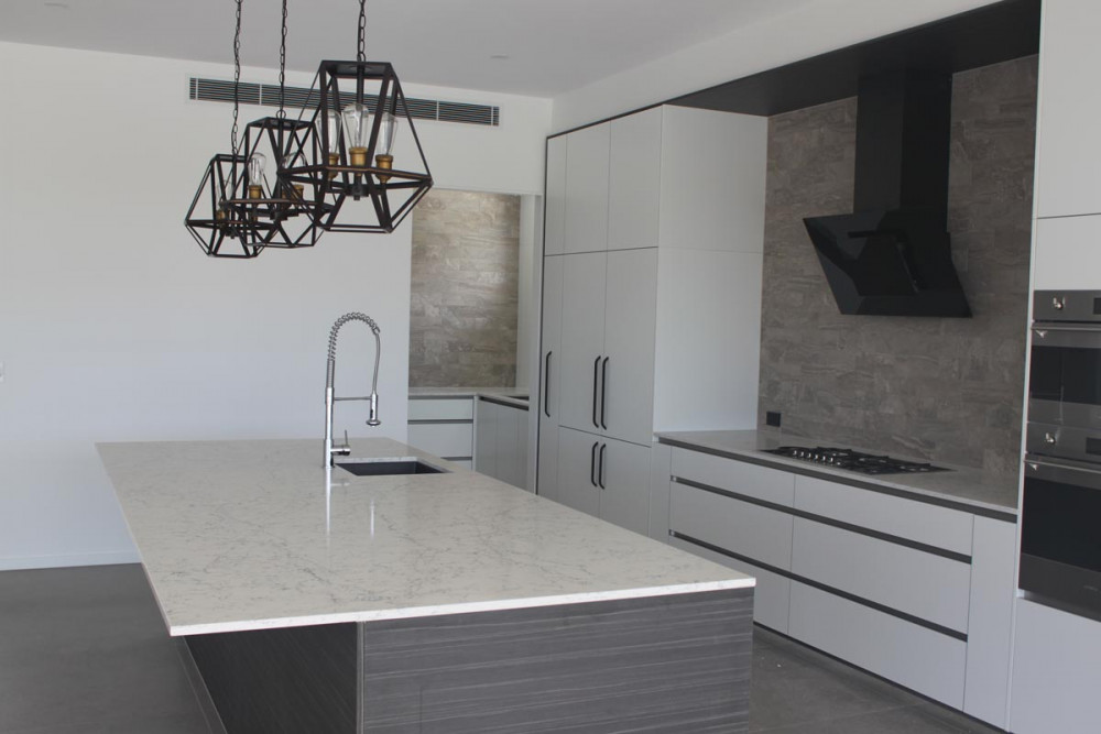 White attica caesarstone kitchen
